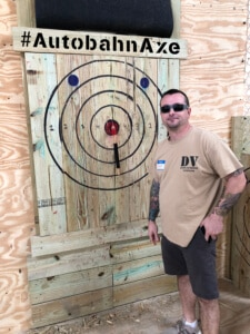 man with target, axe throwing in Birmingham